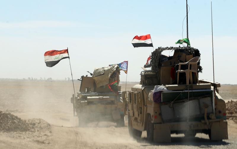 قوات عراقية تتجمع في قاعدة القيارة جنوبي الموصل (أ ف ب)