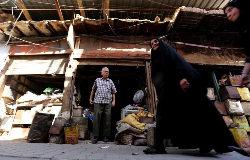 في سوق الدهانة في العاصمة بغداد (أ ف ب)