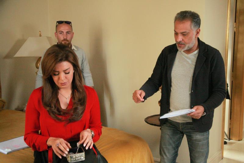 """حاتم علي وأمل بشوشة خلال تصوير """"العراب """""""