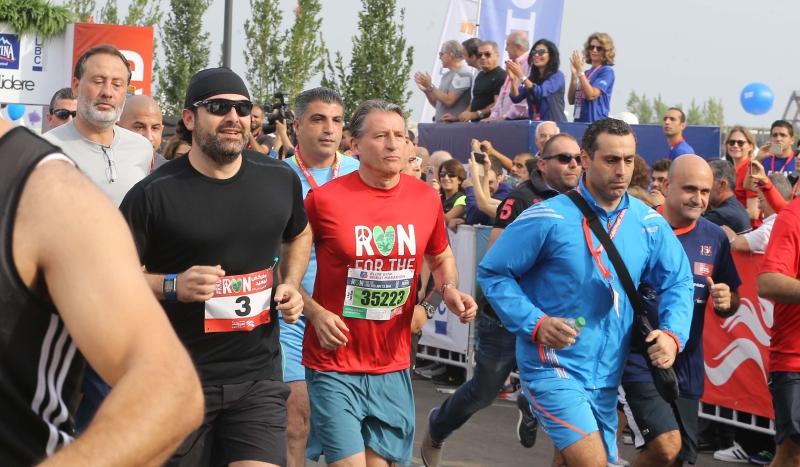 الرئيس سعد الحريري والنائب سيمون أبي رميا خلال السباق