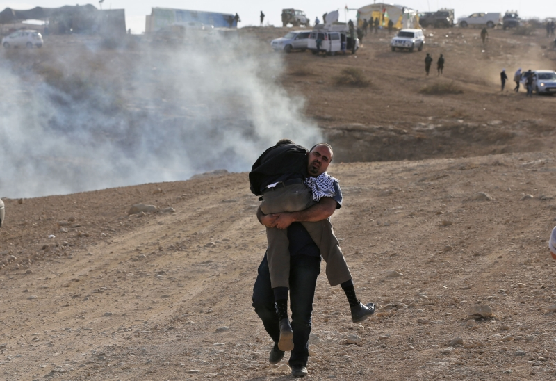 من تظاهرة مناهضة لبناء المستوطنات شمالي نابلس (أ ف ب)