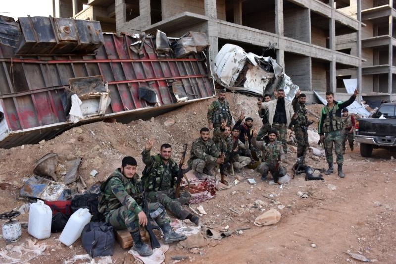 يُتوقّع أن يسعى الجيش إلى استعادة «ضاحية الأسد» خلال السّاعات المقبلة (أ ف ب)