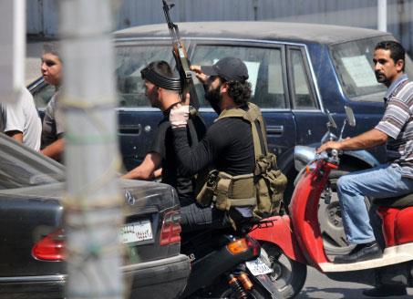 مسلّحو طرابلس يتظاهرون «سلميّاً»