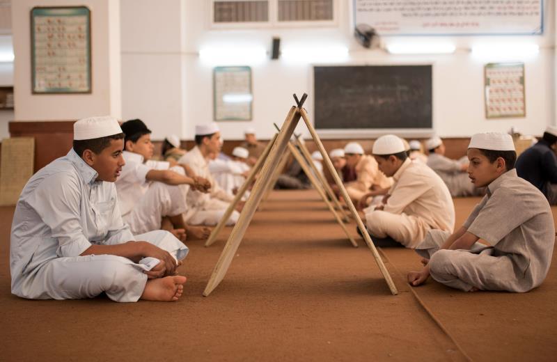 أطفال ليبيون يتعلمون القرآن في مدينة زليتن (أ ف ب)
