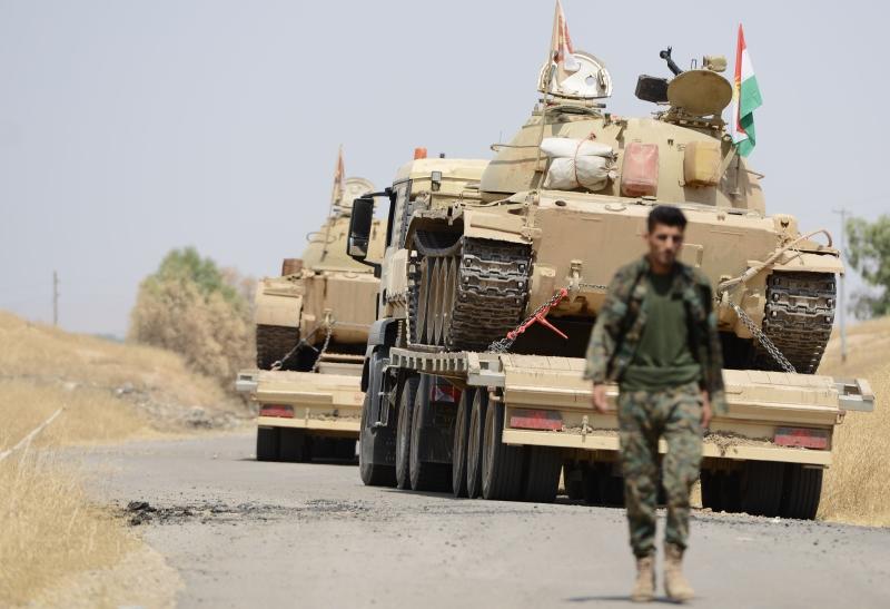 واصل المقاتلون الأكراد التقدم إلى الكنهش الذي كان هدفاً لهجوم بدأ الأحد (الأناضول)