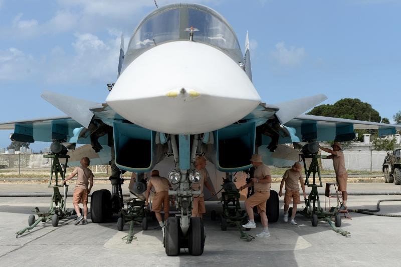 استخدمت روسيا أمس قاعدة همدان الإيرانية في ضربها مواقع المسلحين في سوريا (أ ف ب)