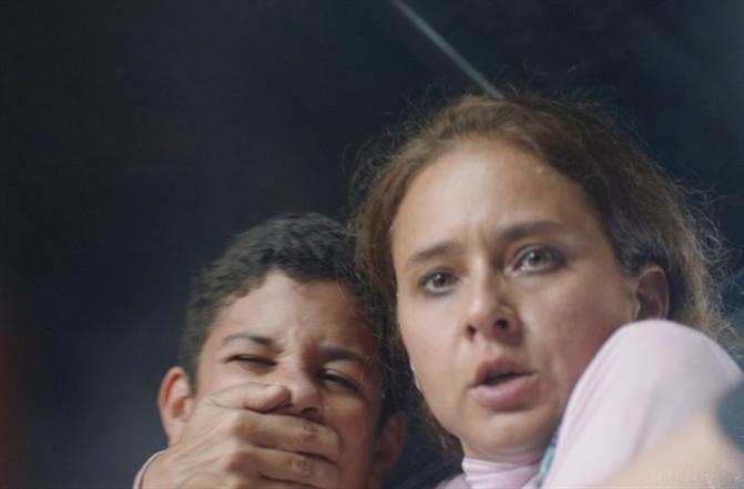 نيللي كريم في مشهد من الفيلaم
