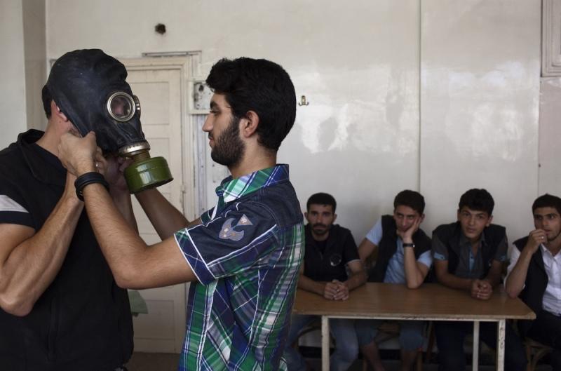 قبل وقوع المجزرة بيومين، كان فريق الأمم المتحدة للتفتيش حول استخدام الأسلحة الكيميائية قد وصل إلى دمشق  (أ ف ب)
