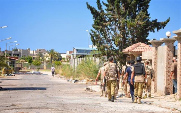 صحيفة جزائرية: حكومة السراج شرعنت التدخل العسكري الأميركي (أ ف ب)
