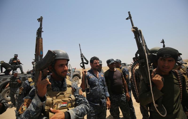 أكد العامري أن «الحشد الشعبي» سيشارك في تحرير الموصل (أ ف ب)