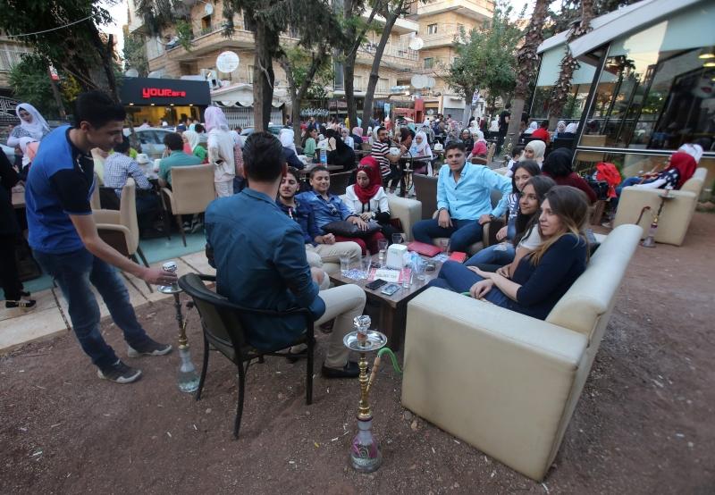 ثاني أيام عيد الأضحى في مدينة حلب أمس (أ ف ب)