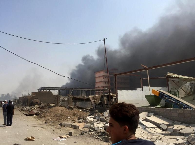 وقع انفجار كبير داخل مستودع لـ{الحشد الشعبي» في منطقة العبيدي شرقي بغداد (الأناضول)