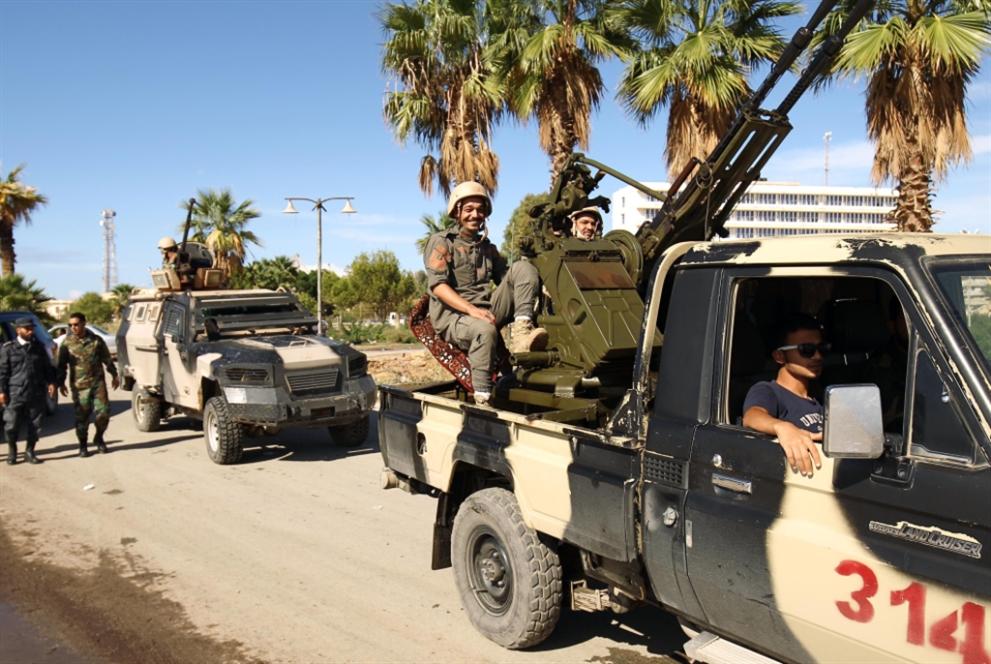 مليارات القذافي في بلجيكا إلى تجار البشر في ليبيا