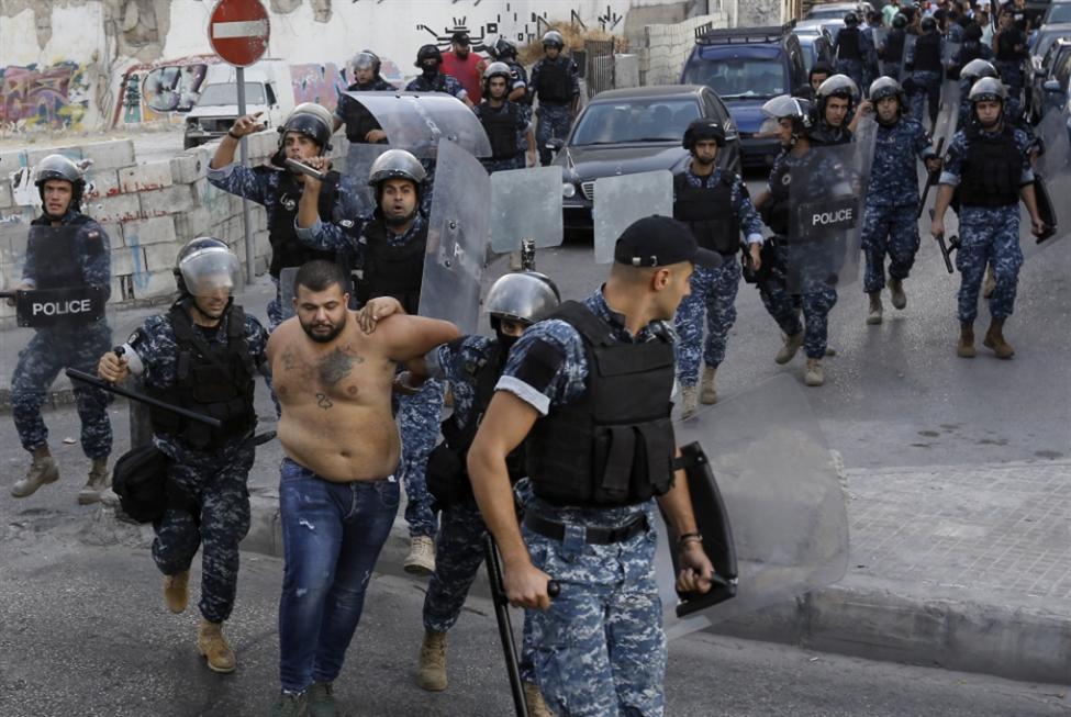احتجاجات طرابلس: إحراق صورة رفيق الحريري!