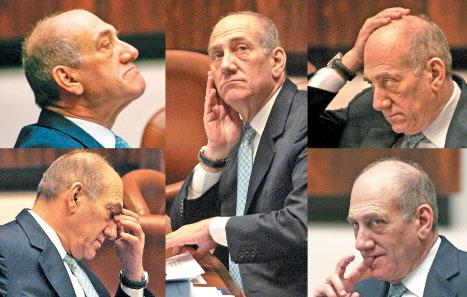 رئيس الوزراء الإسرائيلي إيهود أولمرت خلال جلسة للكنيست أمس (أ ب، رويترز، أ ف ب، إي بي آي)