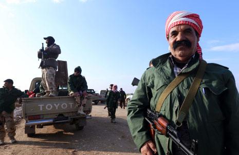 السياسيون العراقيون يرون أن كلمة «ميليشيات» الأجنبية شتيمة، ربما لأن معظمهم آتون أو مدعومون من ميليشيات! (أ ف ب)