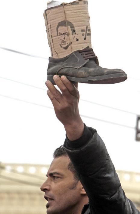 مصير الديكتاتور (عمرو عبد اللّه دلش ــ رويترز)