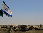 العلم الإسرائيلي فوق دبّابات لجيش الاحتلال في هضبة الجولان المحتلّ الأسبوع الماضي (أرييل شاليط ـــ أ ب)