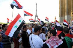 تظاهرة مناهضة للنظام السوري في باريس قبل أيام (أ ف ب)