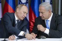 بدأ بوتين جولته من تل أبيب قبل أن ينتقل للضفة الغربية (جيم هولاندر ـ أ ف ب)