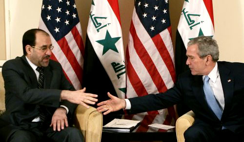 بوش والمالكي خلال اجتماعهما في عمان أمس (رويترز)