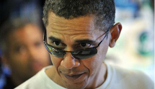 أوباما خلال إجازته في هاواي (جويل صمد ــ أ ف ب)