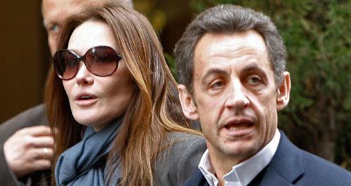 الرئيس الفرنسي نيكولا ساركوزي وعقيلته كارلا بروني في نيويورك أمس (كاثي ولينز ــ أ ب)
