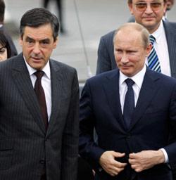 شهد المؤتمر الصحافي بين بوتين وفيّون أخذاً ورداً حول سوريا (شارل بلاتيو ــ رويترز)