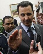 الأسد خلال مشاركته في قمة سرت الشهر الماضي (جوزيف عيد - أ ف ب)