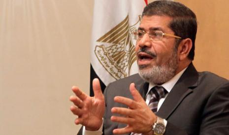 محمد مرسي (أسماء وجيه ــ رويترز)