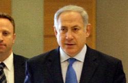 نتنياهو لدى وصوله إلى الكنيست الإسرائيلي في القدس المحتلة أول من أمس (دان باليتي - أ ب)