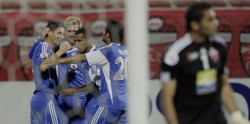 لاعبو الهلال يحتفلون بأحد الأهداف (أ ف ب)